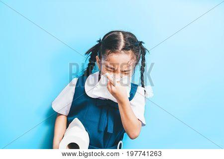asian children with handkerchief having cold .