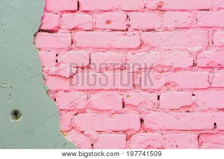 Beautiful abstract background from concrete and Painted pink brick wall texture urban background with space for text. Exposed brick on damaged wall