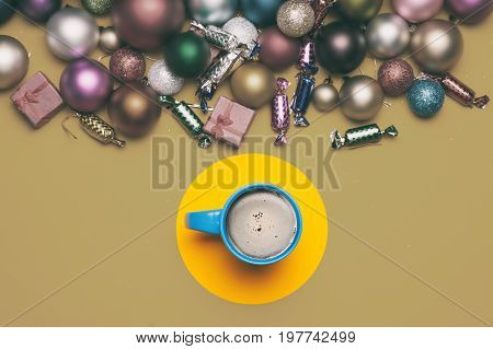 Cup Of Coffee And Christmas Gifts On Yellow Background.