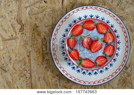 Chia Pudding With Seeds Of Chia Milk And Strawberries