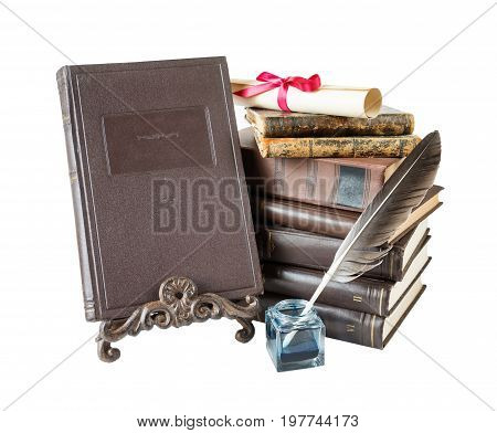 Old hardcover brown books feather pen in inkpot bookrest and scroll tied with red bow isolated on white background
