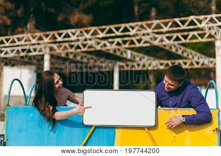 Couple In Love On The Beach With A White Sign