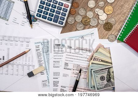Financial Statistics Documents  - Tax Form, Personal Budget With Money, Pen, Calculator