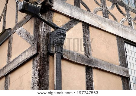 Traditional Gargoyle Style Rainwater Gully On A Tudor Timber Framed Wattle And Daub Building