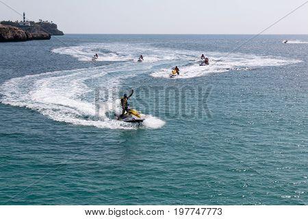 June 18th, 2017, Felanitx, Spain - people riding jet skis near Cala Marcal beach