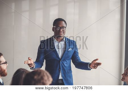 peaceful african american businessman in modern office