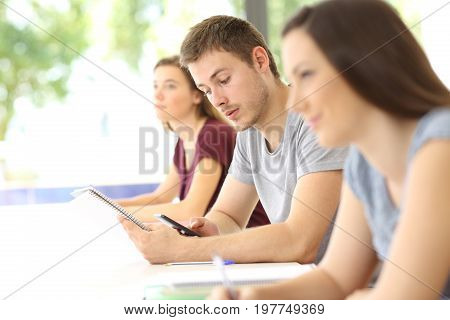 Student Distracted With A Phone During A Class