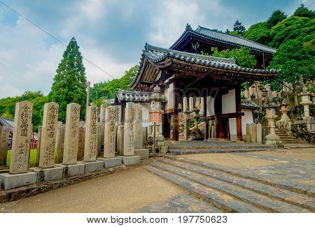 Nara, Japan - July 26, 2017: Principal gate with old traditional architecture and street in Nigatsu-do, Todai-ji temple, Nara, Japan.