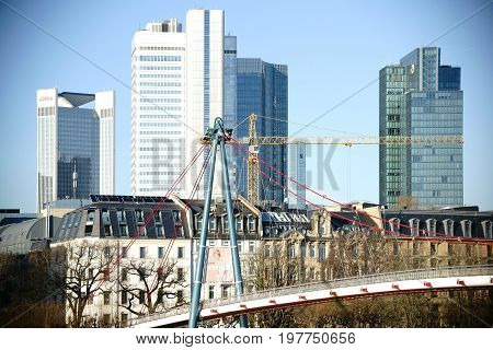 FRANKFURT, GERMANY - JANUARY 05: The skyline of the financial district in Frankfurt with different financial high-rise buildings behind the Holbeinsteg-bridge on January 05, 2017 in Frankfurt.