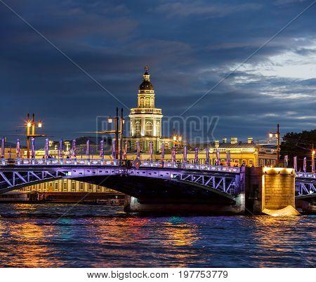 SAINT PETERSBURG/ RUSSIA - JULY 2, 2017. Night view of the Neva river, Palace bridge and Kunstkamera Museum on Vasilevsky island.