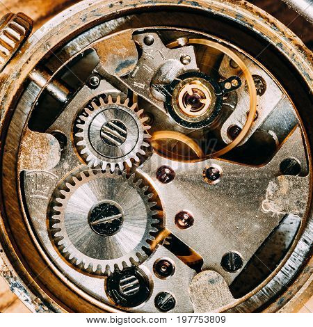 Old Retro Clockwork Background. Close-up Of Clock Watch Mechanism With Gray And Golden Gears. Vintage Mechanism With Movement Mechanics