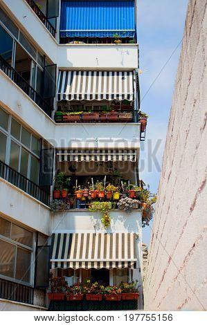 Balcony. Urban house façade. Marbella city, Costa del Sol, Andalusia, Spain. Photo taken - 26 july 2017.