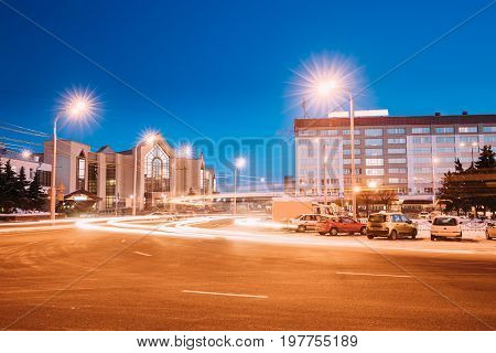 Gomel, Belarus. Railway Station Building And Hotel At Morning Or Evening. Train Station At Night Time In Winter Season.