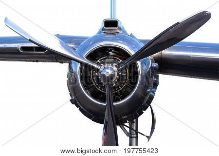 Close up of B-25 bomber aircraft piston radial angine with wing section isolated on white, polished allumium, shiny surface, polished