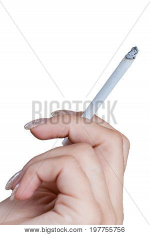 Female Hand holding a cigarette isolated on white background, fingernails nicely manicured, cigarette is lit