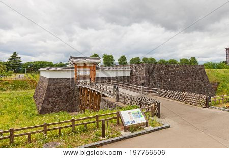 YAMAGATA JAPAN - MAY 28 2017: Reconstructed Otebashi Bridge (2005) and Ichimonji Gate (2014) of Main Bailey of Yamagata Castle (founded in 1356). National historical site of Japan since 1986