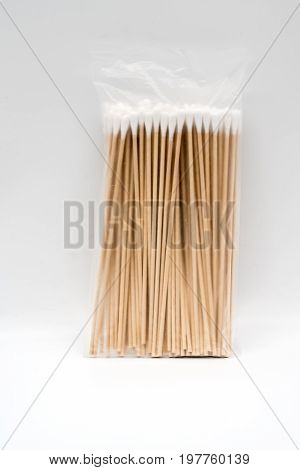 A translucent plastic pack of pasteurized cotton wool on bamboo stick for medical use