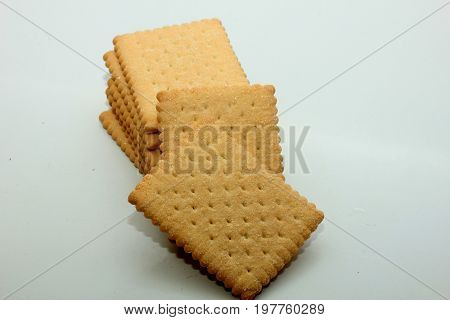 Stacked plain bisuits on a white background