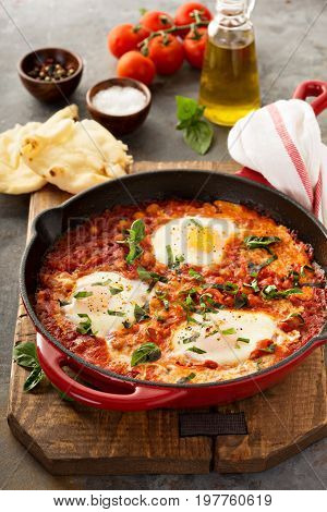 Shakshuka with chickpeas in a cast iron skillet