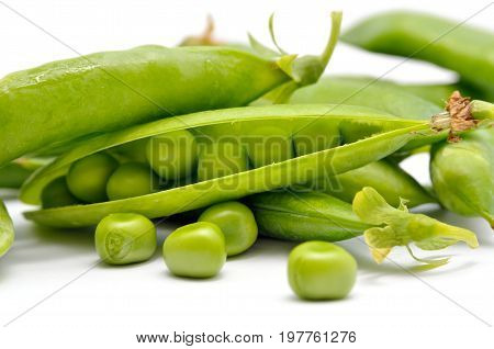 Pods Of Green Peas Isolated On A White Background. Green, Ripe, Fresh Vegetables. Legumes.