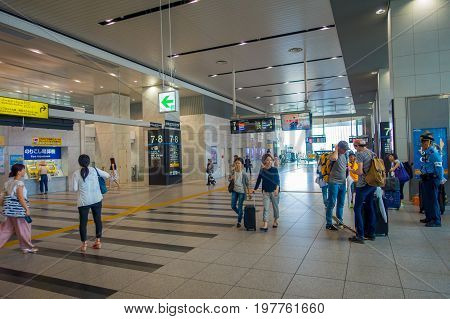 OSAKA, JAPAN - JULY 18, 2017: Unidentified people at Kansai International Airport, Osaka. It is an international airport located on an artificial island in the middle of Osaka Bay.