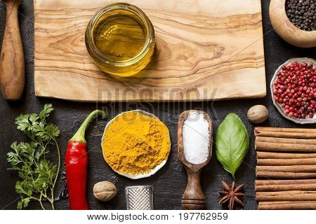 Various herbs and spices on black background