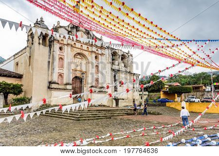 San Juan del Obispo Guatemala - June 11 2017: Decorating one of first Catholic churches in the country for Corpus Christi celebrations. The first bishop of Guatemala lived in the village near the UNESCO World Heritage Site of Antigua.