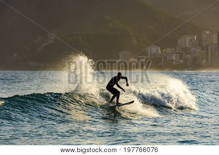 Silhouette of Surfer on Ipanema beach in Rio de Janeiro