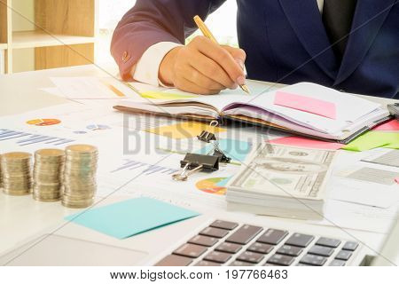 Business finance concept,Business people are analyzing the work and taking notes,Business people are analyzing financial information and taking notes.