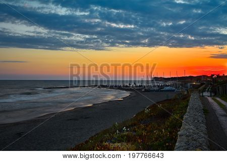 Dramatic sunset viewed from the beach at Marina di San Nicola Lazio Italy.