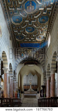 VOLTERRA ITALY - MARCH 17 2014: Interior of the Roman Catholic cathedral dedicated to the Assumption of the Virgin Mary the seat of the bishop of Volterra.