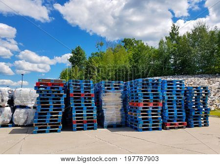 Stacks of blue palettes behind a superstore