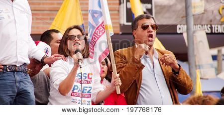 Quito, Ecuador - April 7, 2016: Unidentified people with ecuadorian and white flags talking in microphone and supporting the presidential candidate Guillermo Lasso, and journalists during anti government protests in Shyris Avenue.