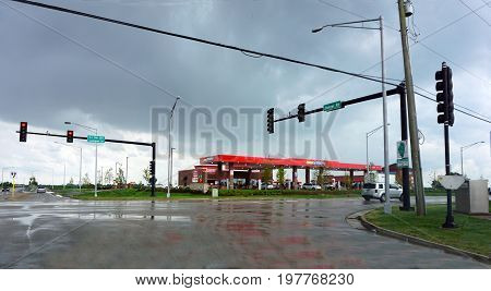 PLAINFIELD, ILLINOIS / UNITED STATES - JUNE 30, 2017: Motorists purchase gasoline at the Gas N Go, at the intersection of Lockport Street (ILL Rte 126) and Stainer Road, on a stormy summer day.