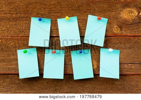 Weekly Schedule With Blue Empty Stickers On Brown Wooden Background