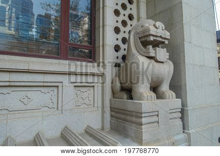 Lion statue, near the headquarters building of the Hongkong Banking Corporation in the city of Hong Kong, china.