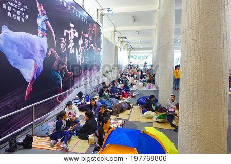 HONG KONG, CHINA - JANUARY 26, 2017: Unidentified foreign nannies on day off resting in downtown Hong Kong.