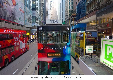 HONG KONG, CHINA - JANUARY 26, 2017: Two double-deck busses in Hong Kong, China. The Double-deck trams system in Hong Kong is one of three and the most famous in the world.