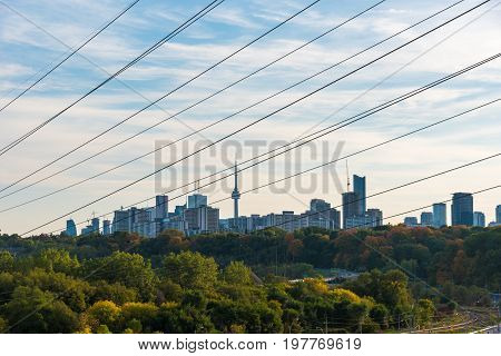 Toronto cityscape panorama with green trees and wires. Ontario Canada
