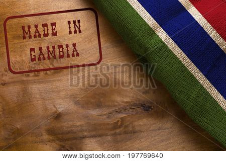 Stamp Made in Gambia poster with the national flag of Gambia.