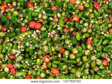 Fresh red and green Thai chili in fish sauce. Close up sliced chili for texture and background.