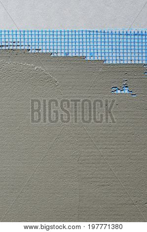 The Texture Of The Wall, Covered With Gray Foam Polystyrene Plates, Covered With A Blue Reinforcing