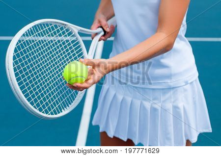 Tennis Player Holding Tennis Racket And Ball In Hand  On The Tennis Court