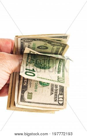Hand holding small amount of American money