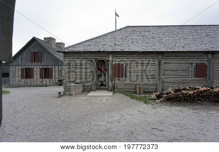 MACKINAW CITY, MICHIGAN / UNITED STATES - JUNE 18, 2017: Visitors may enter a longhouse in Fort Michilimackinac, in the Colonial Michilimackinac State Park, to view exhibits about the fort's history.