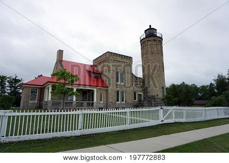 The Old Mackinac Point Lighthouse, whose fog light once guided ships through the Straits of Mackinac, between Lakes Michigan and Huron, houses a maritime museum in Mackinaw City, Michigan.