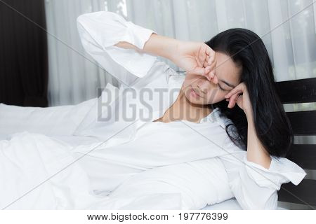 Beautiful Woman Waking Up In Her Bed