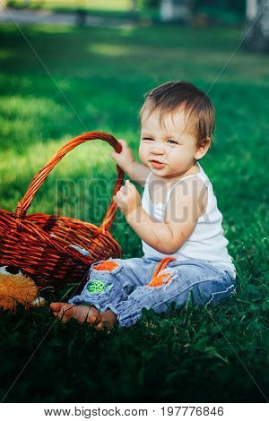 Quite extraordinary funny portrait of baby holding basket