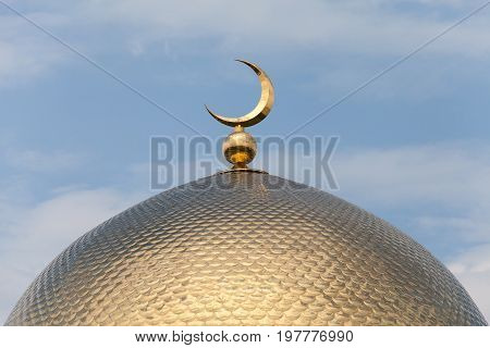 Beautiful dome of mosque golden shine against the blue sky