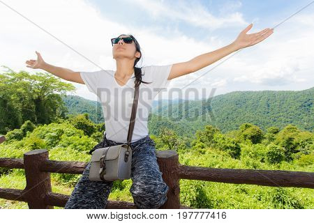 Young Woman Arms Raised Enjoying The Fresh Air